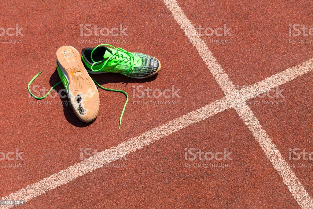 broken green running shoes stock photo