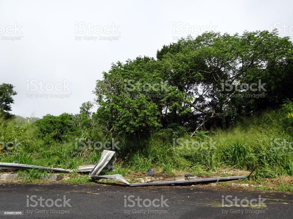 Broken Guard Rail on Turn in Road stock photo