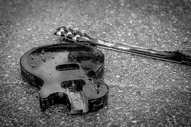 broken guitar - broken guitar stock photos and pictures