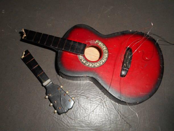 broken guitar toy - broken guitar stock photos and pictures
