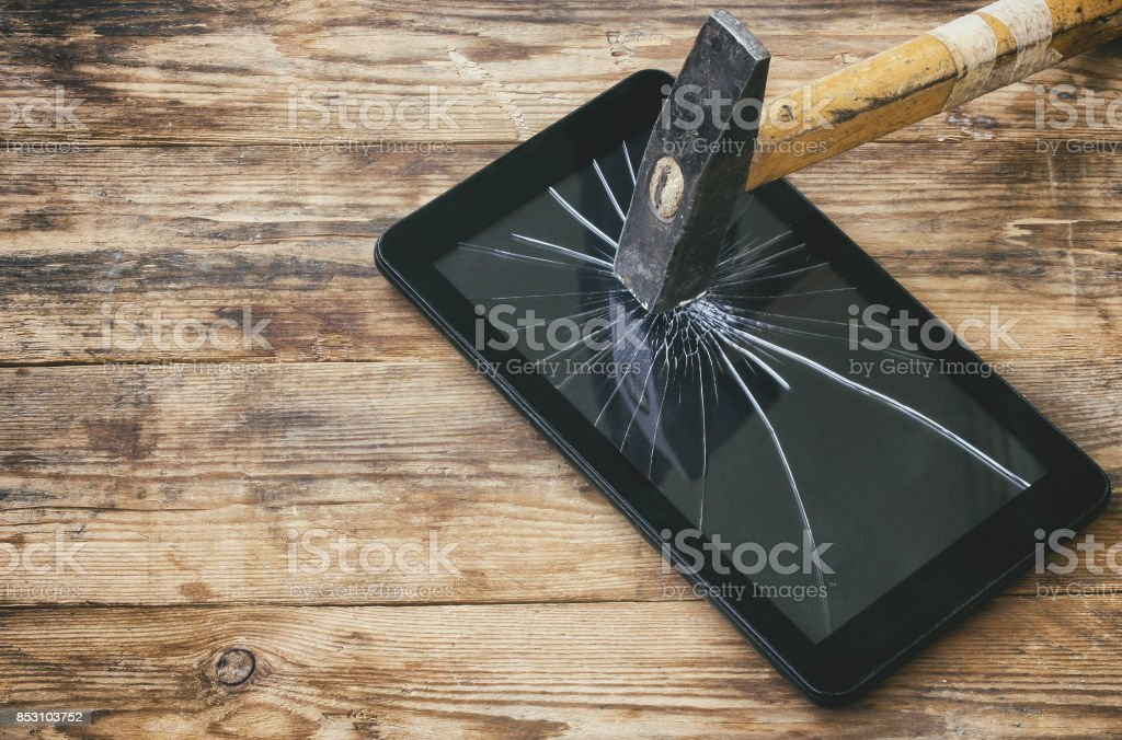 broken hammered tablet computer stock photo