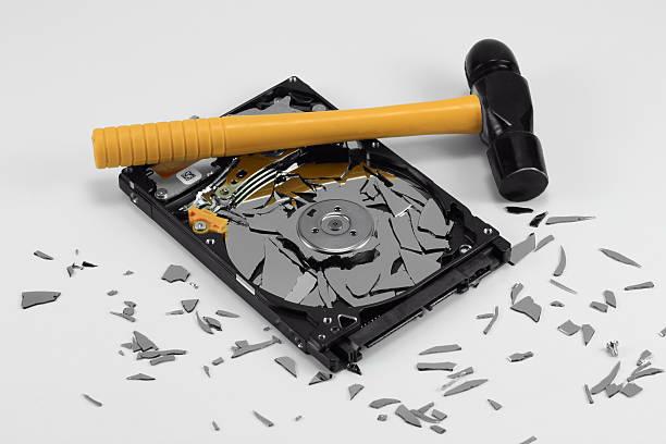Broken Hard Disk Drive and Hammer stock photo
