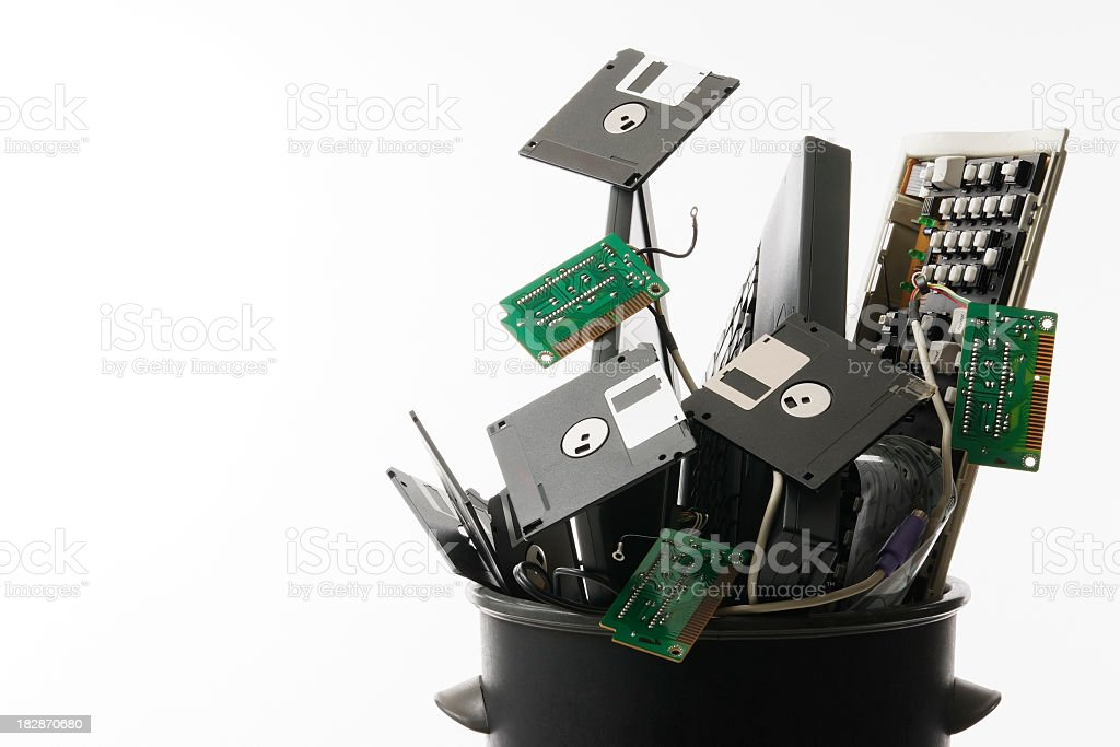Broken hardware in trash can against white background royalty-free stock photo