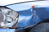 istock Broken headlight in car crash accident on damaged car with dented sheet selective focus 877825968