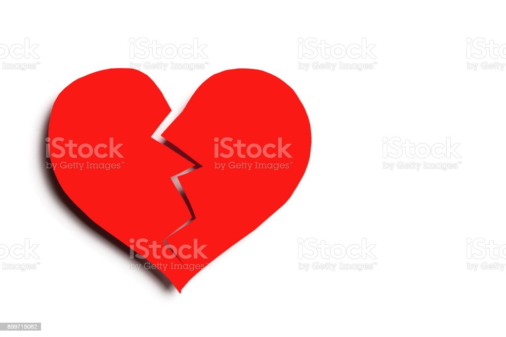Broken heart isolated on white background with copy space. Cut out stock photo