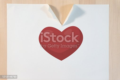 182781451 istock photo Broken heart on a tearing paper on the table and breaking heart concept 1213146793