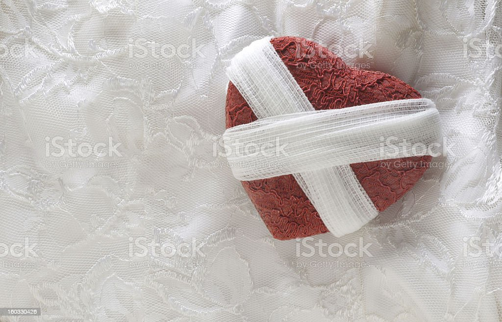 Broken Heart Wrapped With Gauze royalty-free stock photo