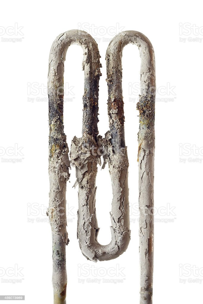 Broken heating element closeup with sediment - bad water quality stock photo