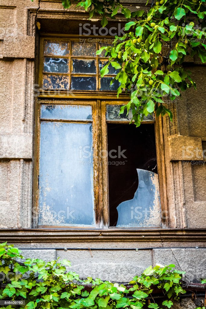 Broken house window stock photo