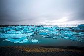 Broken ice blocks in the water in Iceland