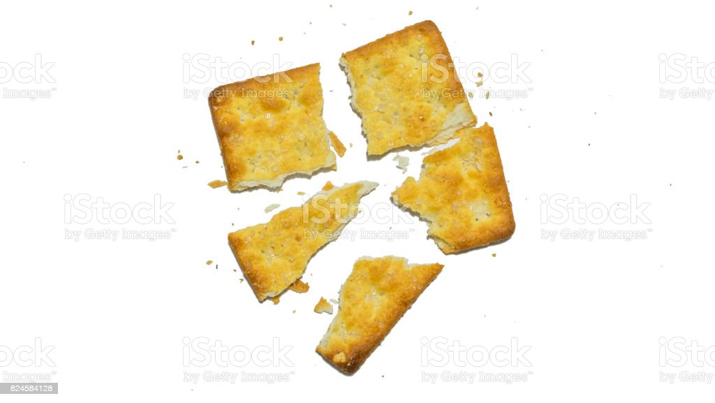Broken in pieces of single sugar cracker stock photo