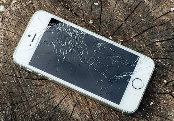 broken iphone - broken iphone stock photos and pictures