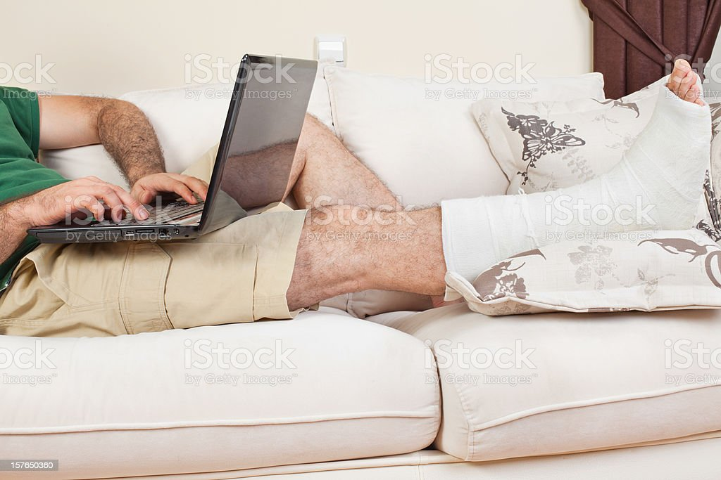 Broken Leg and Working in Home Office royalty-free stock photo