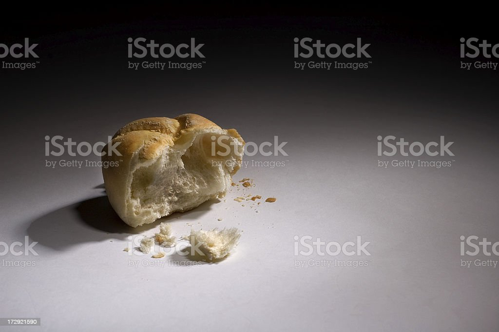 Broken Loaf of Bread with Crumbs royalty-free stock photo