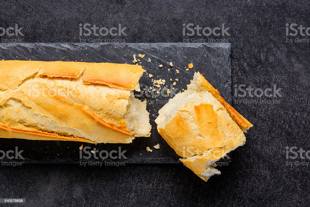 Broken Loaf of French Bread stock photo