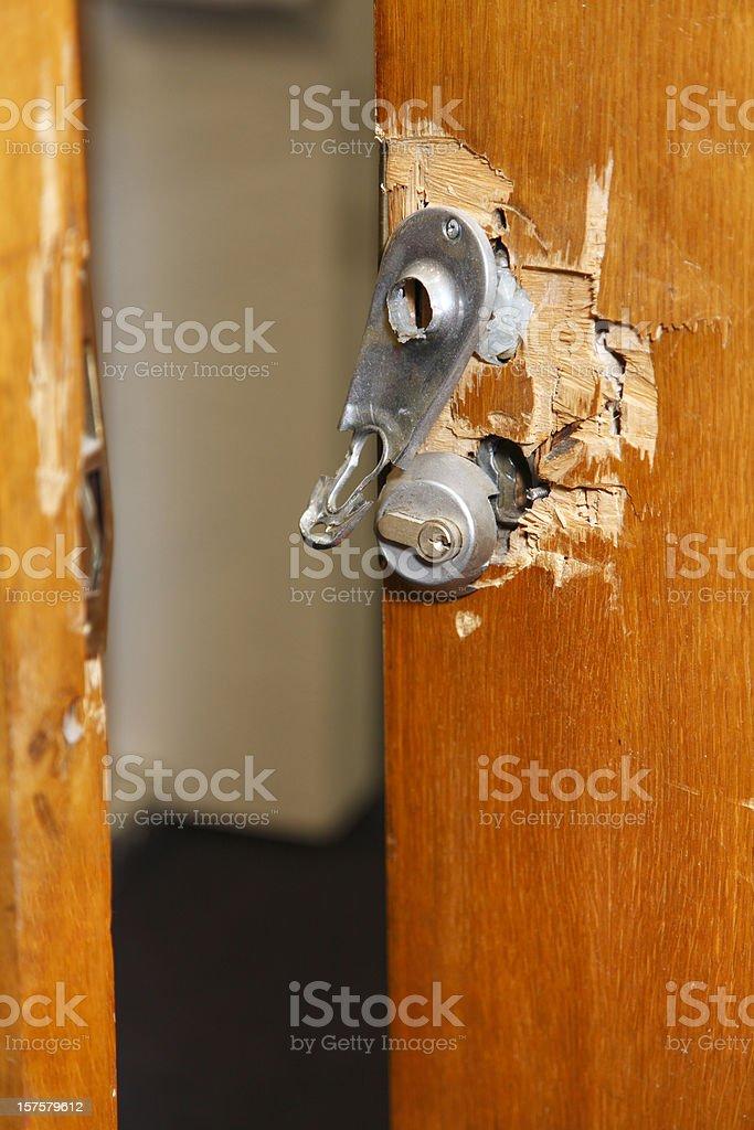 Broken lock and door frame damaged from break-in stock photo