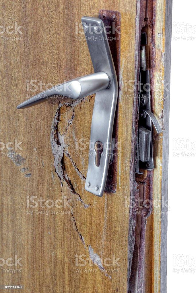 Broken lock smashed on door jam stock photo