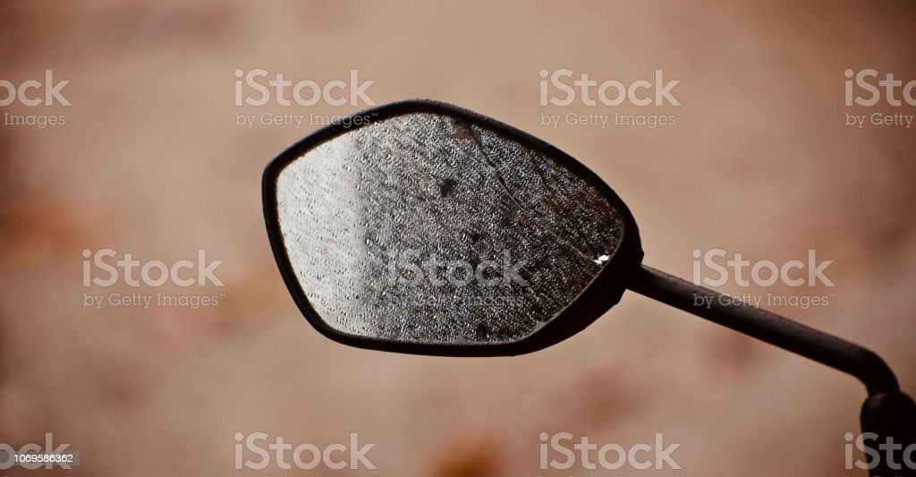 A broken looking glass of a bike stock photo