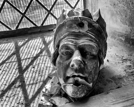 Broken medieval sculpture on a church windowsill