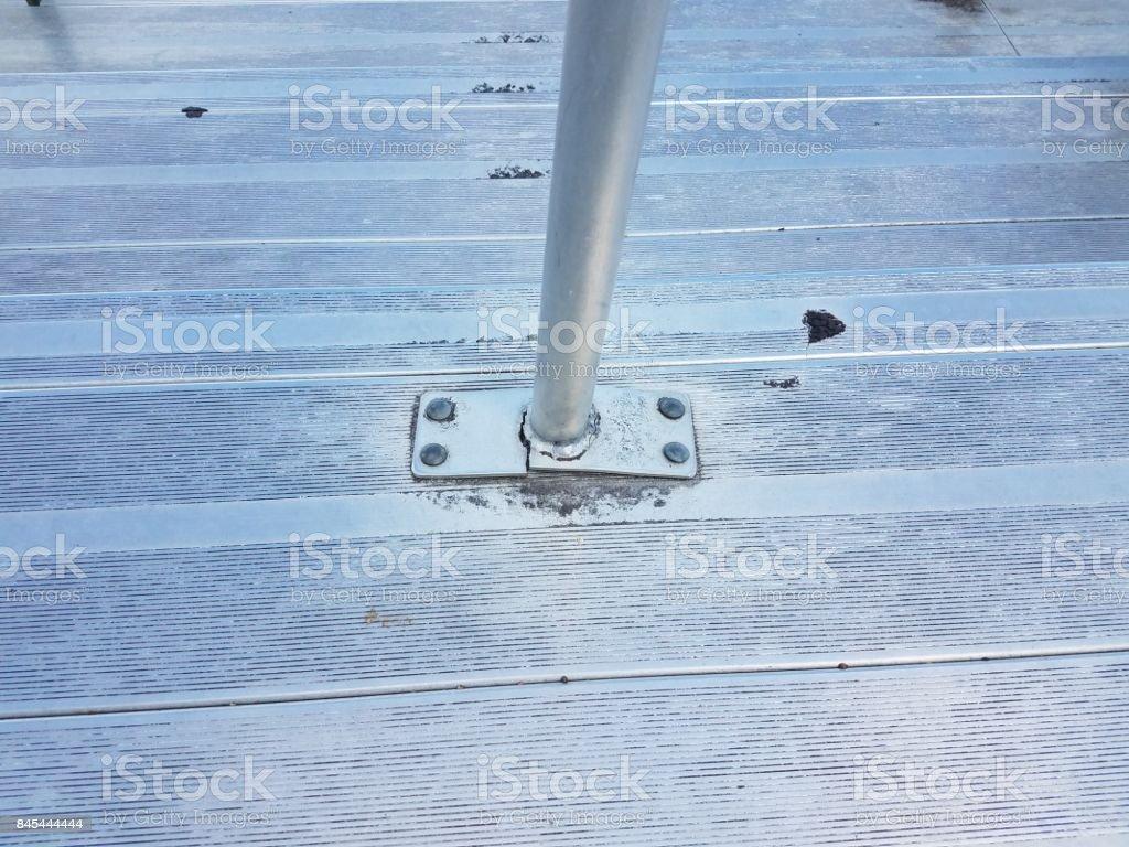 broken metal post on metal bleachers or sports seating stock photo