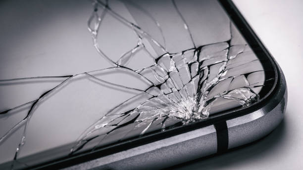 Broken mobile phone screen close up. Weak glass in modern gadgets Broken mobile phone screen close up. Weak glass in modern gadgets broken stock pictures, royalty-free photos & images