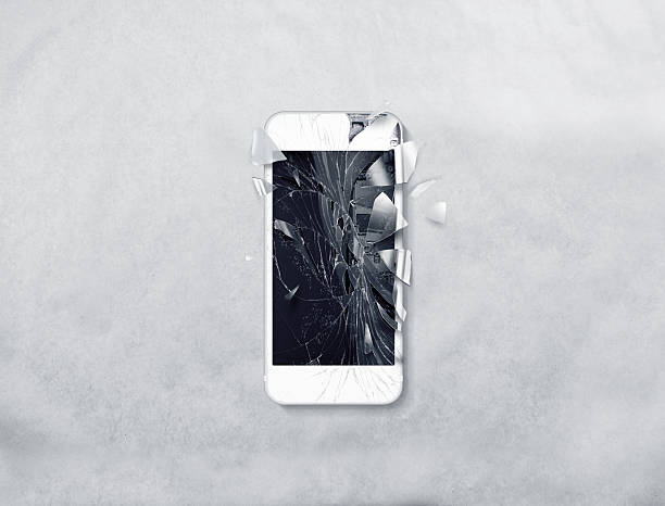 Broken mobile phone screen, scattered shards. – Foto