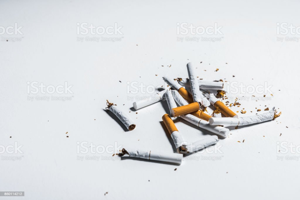 Broken nicotine objects on table stock photo