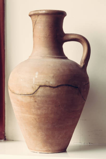 Broken old clay vintage greek vase stock photo