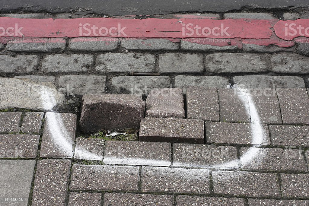 Broken pavement damaged sidewalk kerb raised bricks marked for repair stock photo