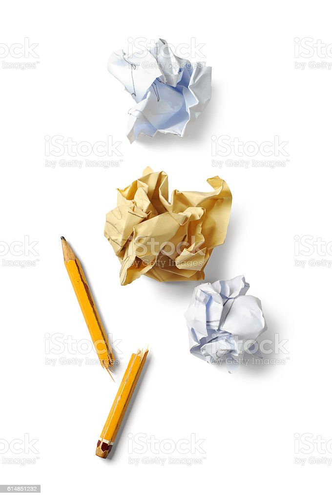 Broken pencil and crumpled paper stock photo