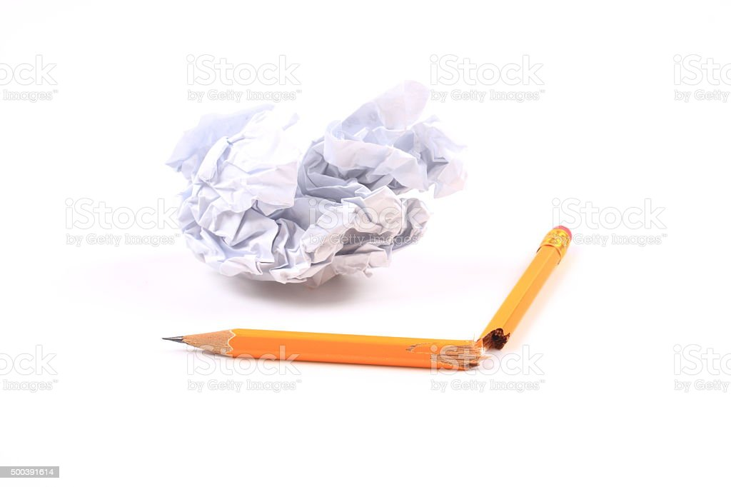 Broken pencil and waste paper stock photo