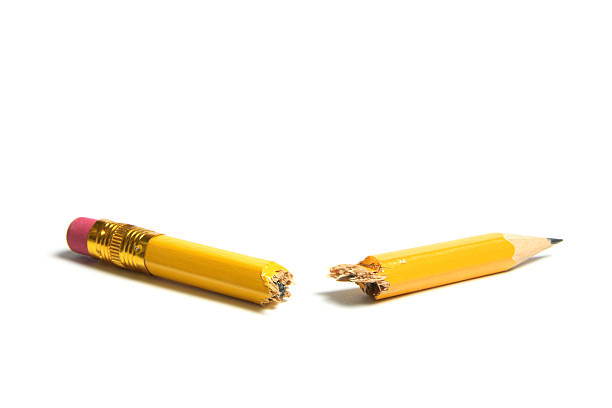 Broken Pencil Broken Pencil on Isolated White Background snapping stock pictures, royalty-free photos & images