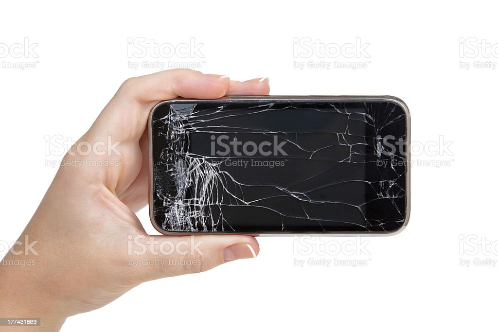 broken phone in a female hand royalty-free stock photo