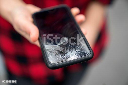 Broken phone in a female hand