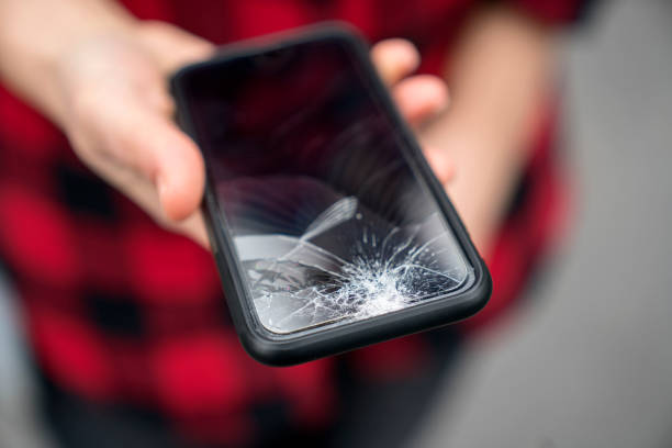 Broken phone in a female hand stock photo