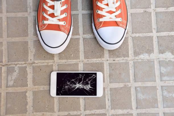 broken phone - broken iphone stock photos and pictures