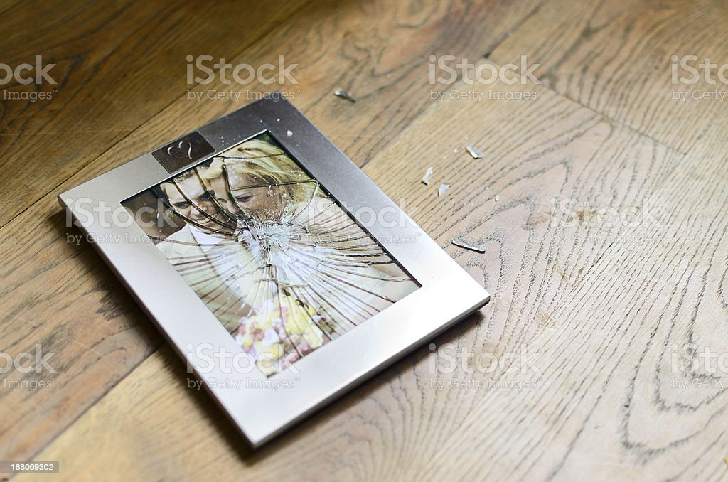 Broken picture frame with married couple stock photo