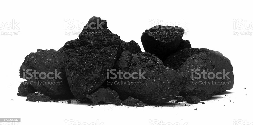 Broken pieces of charcoal, coal isolated against white royalty-free stock photo