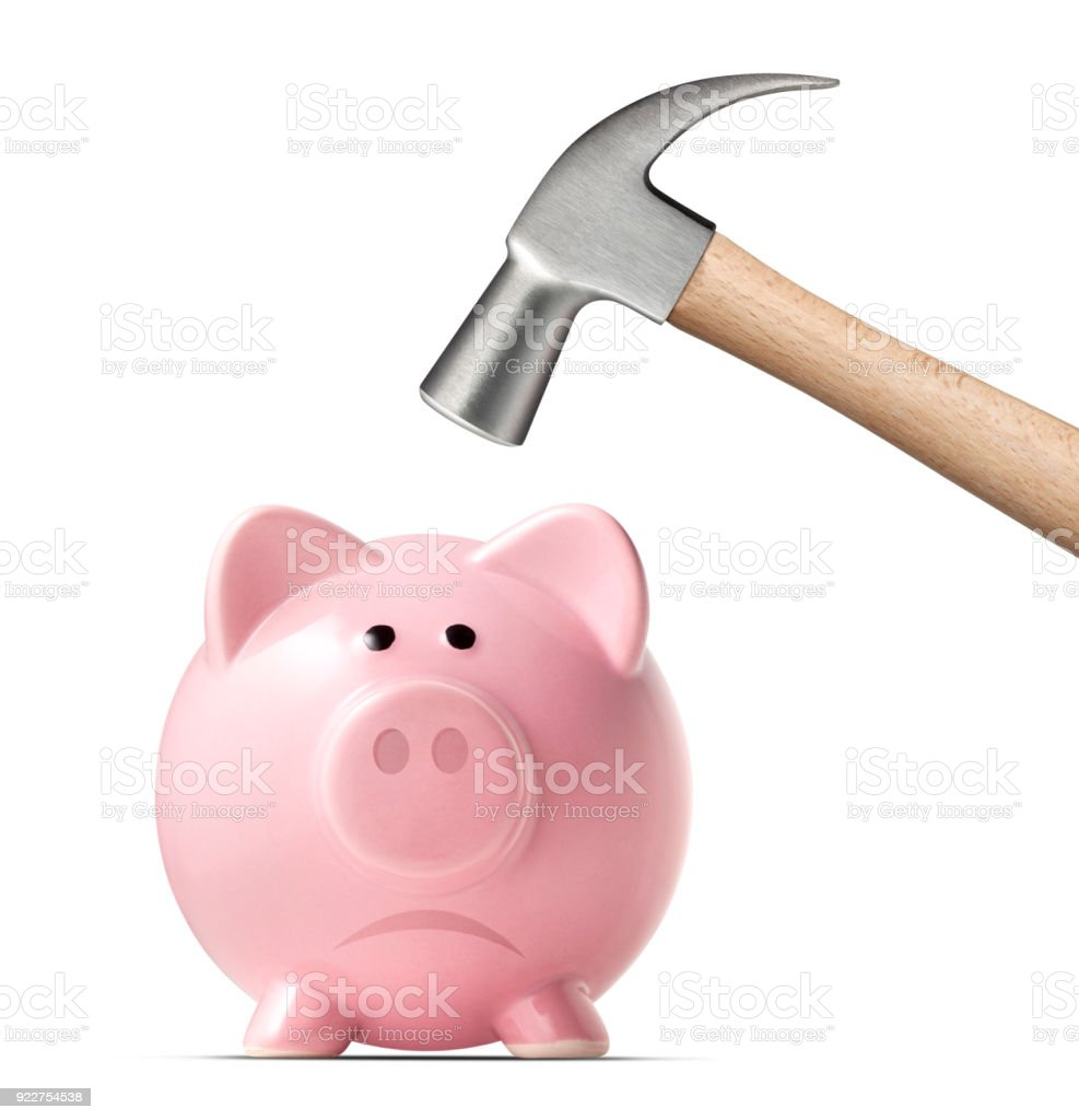 Broken piggy bank by hammer on white background stock photo