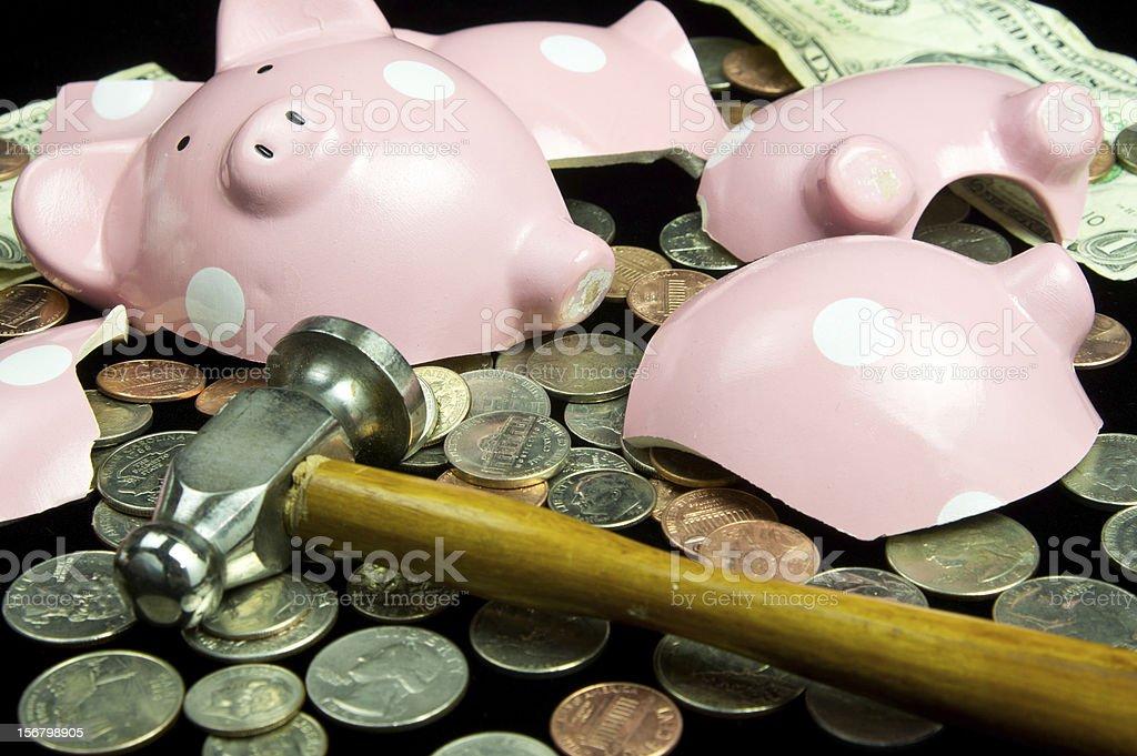 Broken piggy bank full of money stock photo