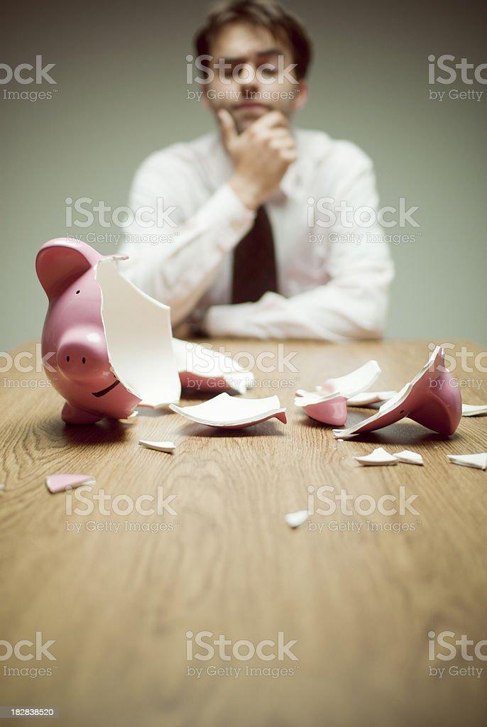 Broken Piggy Bank Businessman being clueless about an empty piggy bankSee also: Businessman Stock Photo