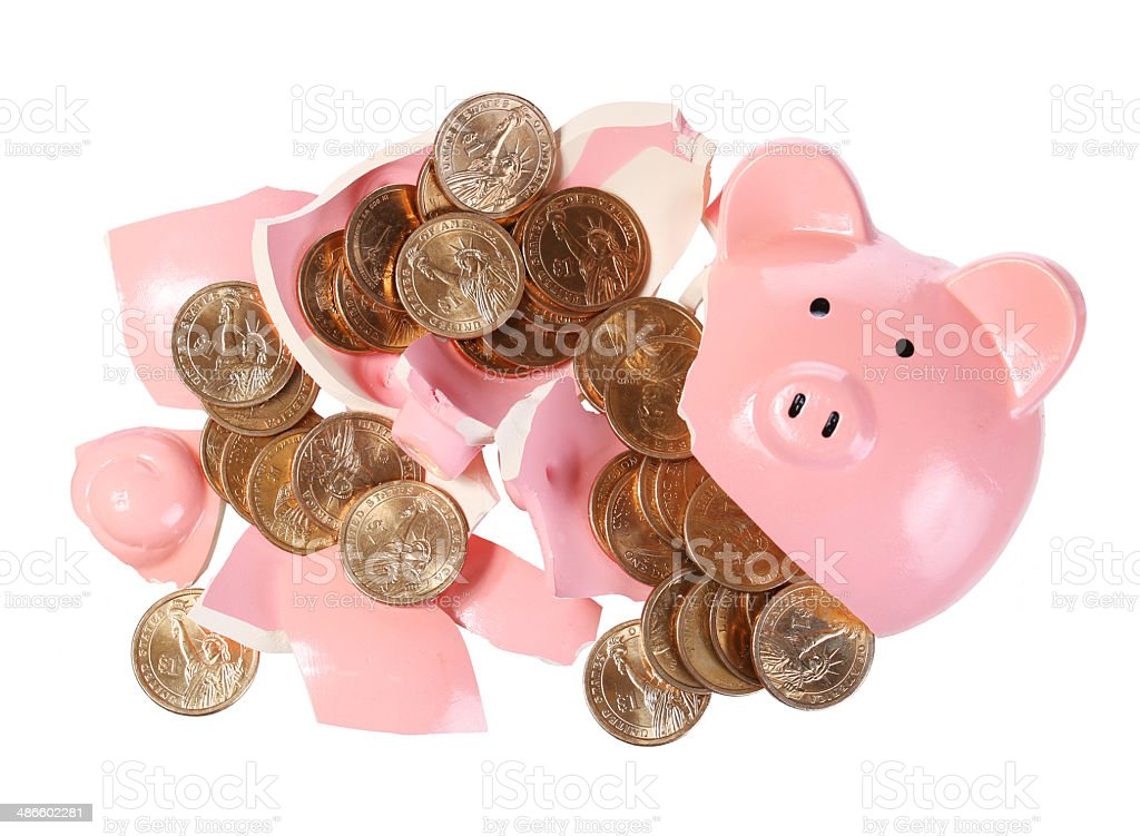 Broken Piggy Bank with Gold Coins isolated stock photo