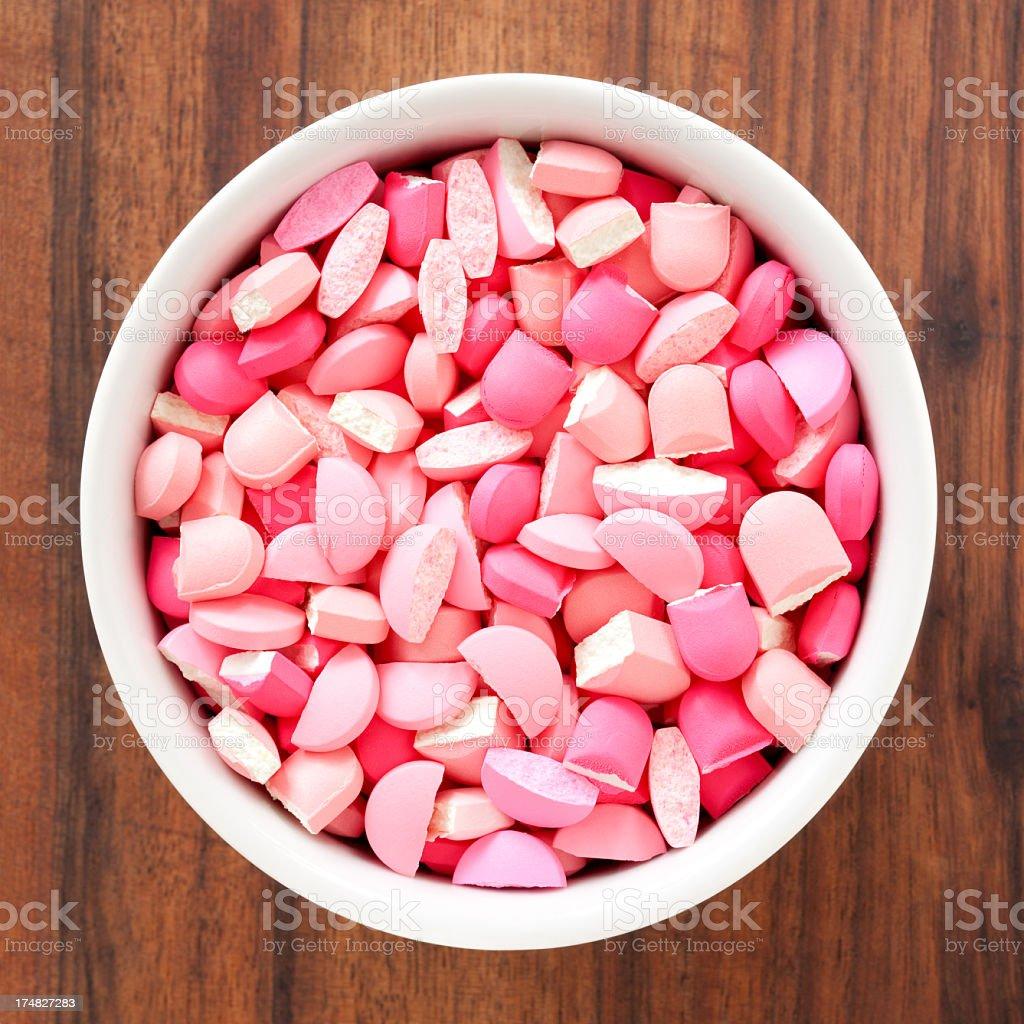 Broken pink pills royalty-free stock photo