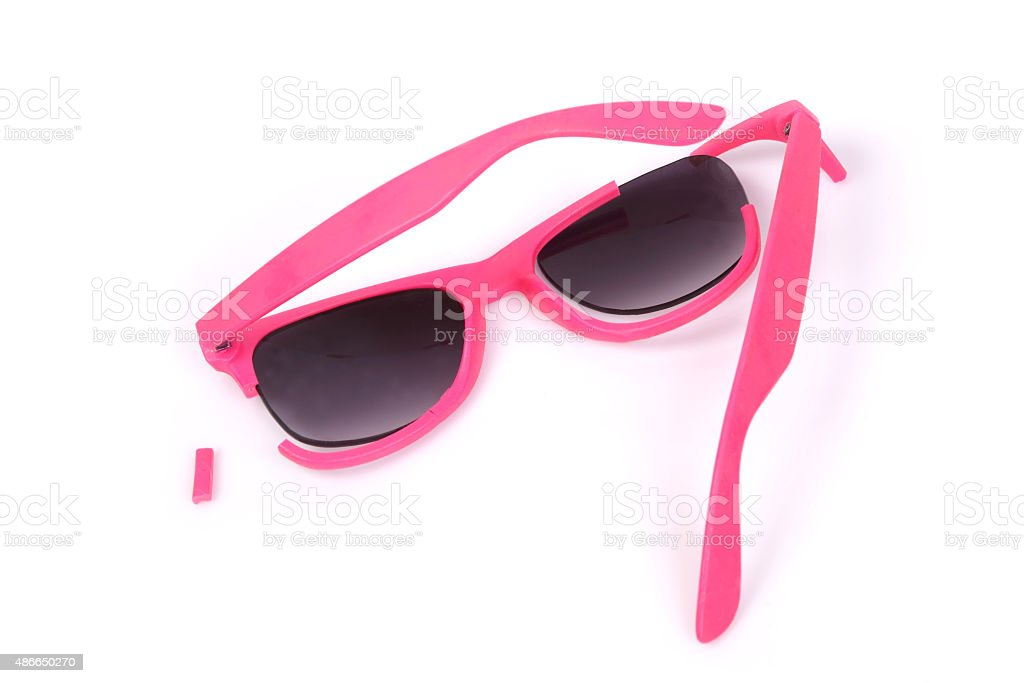 Broken pink sunglasses. stock photo