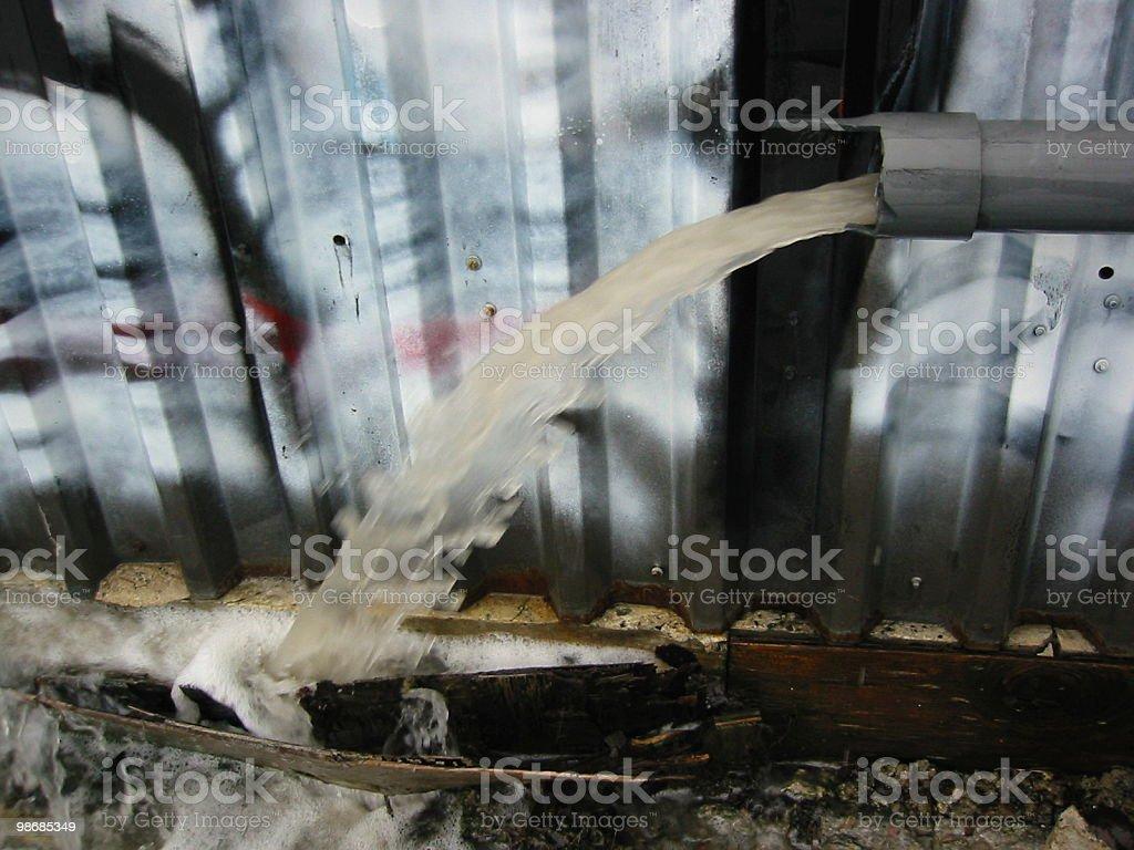 Broken pipe spews foamy, dirty water royalty-free stock photo