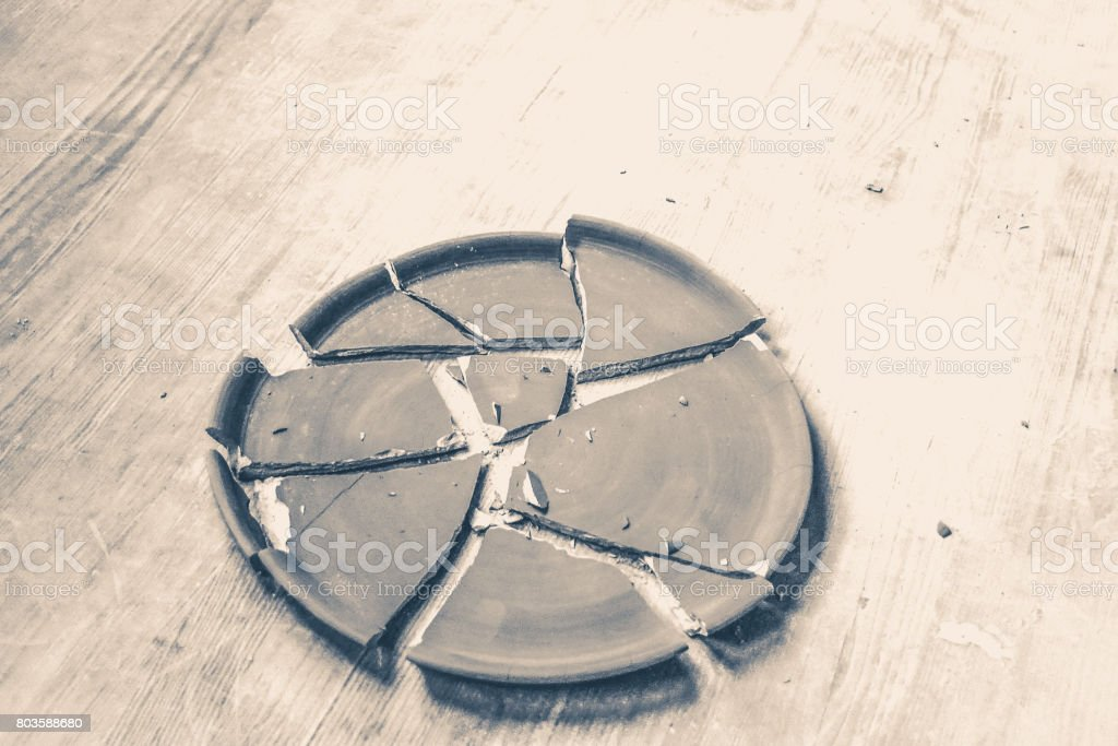 Broken Plate Lying On A Wooden Table Stock Photo Download Image Now Istock