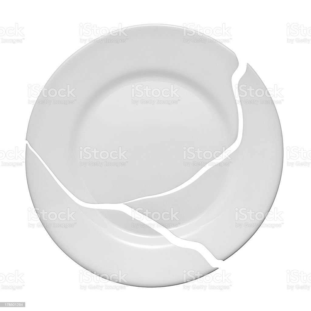 Broken plate on a white background stock photo