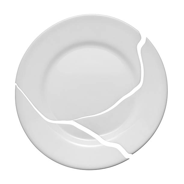 broken plate on a white background - gebroken bord stockfoto's en -beelden