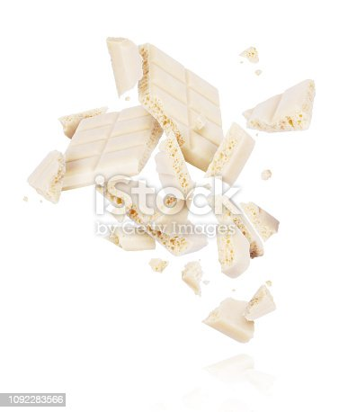 istock Broken porous white chocolate fall down isolated on white background 1092283566