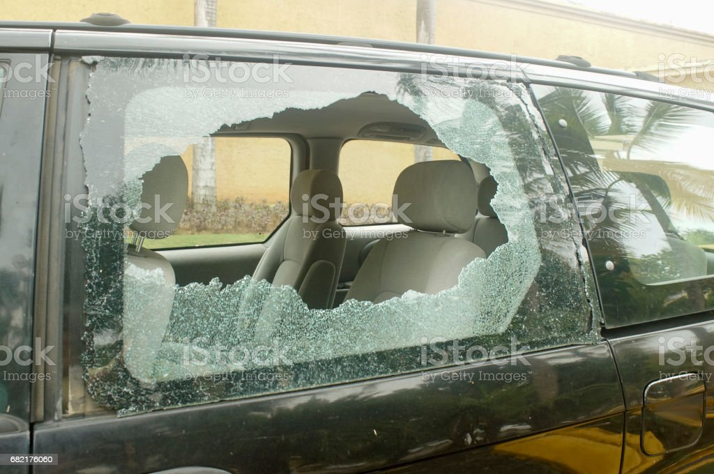broken rear glass in the car, accident risk stock photo